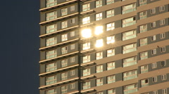 Time lapse of interesting reflective sunlights on glasses of the skyscraper Stock Footage