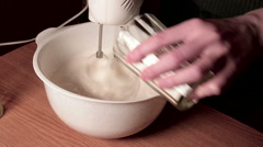 Mixer knoks egg whites and pour flour Stock Footage
