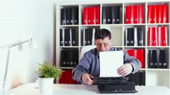 Writer typing on an old typewriter in the office Stock Footage