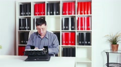Writer typing on an old typewriter in the office - stock footage