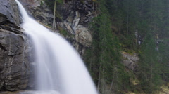 Closeup view of water falling down to rocks. Timelapse panning down video Stock Footage