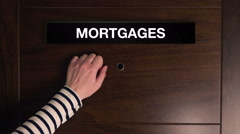 Mortgages concept, female hand knocking on door Arkistovideo