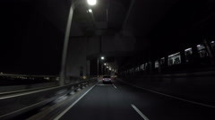 Car driving along the fully automated Yurikamome train. - stock footage