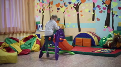 Little boy playing in the playroom - stock footage