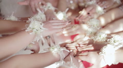 Close Up many hands girls bridesmaid bride with boutonniere on his hands Stock Footage