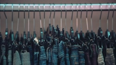 Hanger with jeans - stock footage