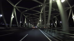 Nightscape driver's POV through the illuminated Kachidokibashi Bridge. - stock footage