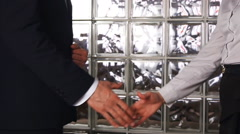 Clouse-up of businessman and  businesswoman shaking hands Stock Footage