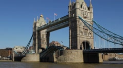 London's Tower Bridge lifts up its drawbridge admit a boat - stock footage