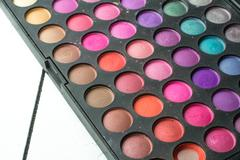 Palette of colorful eye shadows on wood white background Stock Photos