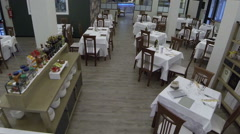 A large dining room ready for service Stock Footage