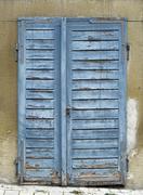 rundown blue door - stock photo
