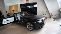 Black Rolls Royce on the exibition - stock footage