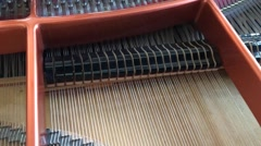 Close-Up of Strings Acoustic Grand Piano Self-Playing Jazz. Arkistovideo