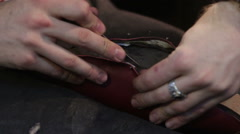 Shoemaker sews shoes. Cut leather Stock Footage