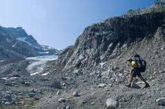 Male climber near Chickamin Glacier, Ptarmigan Traverse, North Cascades, Wash - stock photo