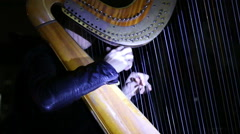 girl playing classical music on a harp concert - stock footage