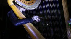 Girl playing music on a harp concert Arkistovideo