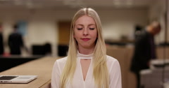 "4k, Attractive blonde businesswoman nodding her head ""yes"" Stock Footage"