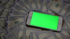 Smartphone where green background. 100 dollars . clous-up Stock Footage