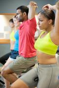 People stretching on spin machines Stock Photos