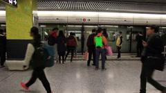 Crowd of passengers walk in Tsim Sha Tsui station  Stock Footage