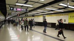 Crowd of passengers walk in Tsim Sha Tsui station Stock Footage