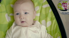 Happy Little Cute Baby Girl Swing in Electric Chair Bouncer Stock Footage