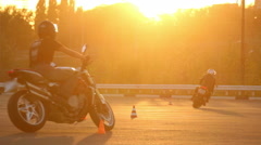 Motorcycle Driving Lessons Moto Gymkhana Motorcyclists At Sunset Stock Footage