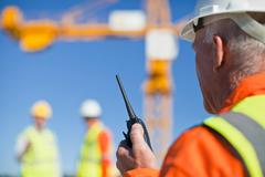 Worker using walkie talkie on site Stock Photos
