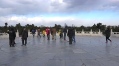 Tourists on the 'Heaven's Heart' stone in the Circular Mound Altar. Beijing Stock Footage