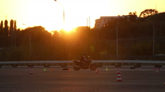 Motorcycle Driving Lessons Moto Gymkhana Motorcyclists At Sunset Timelapse Stock Footage