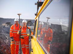 Portrait of surveyors in opencast coalmine Stock Photos