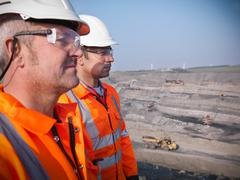 Profile of miners in opencast coalmine Stock Photos