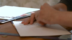 Artist Draws Picture of a Pencil Sketch on Paper Stock Footage