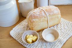 Stock Photo of Loaf of bread with butter and salt