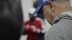 Professional african american athlete training as boxer In gym with punching bag Stock Footage