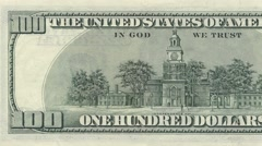 Hundred dollar note reverse dolly shot from left to right showing 100 symbols 4k Stock Footage