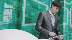 Businessman behind the podium working on the tablet - stock footage