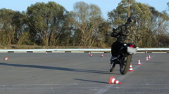 Motorcycle practice in traffic between cones Moto Gymkhana Motorcyclists Stock Footage