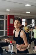 Beautiful girl on a treadmill Stock Photos