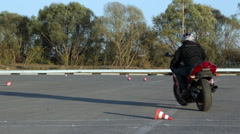 Motorcycle Driving Lessons between traffic cones Moto Gymkhana Motorcyclists - stock footage