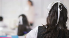 4K Happy school children in class listening to teacher & answering questions - stock footage