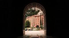 View through the arch at the abbey Santa Maria de Montserrat. Stock Footage