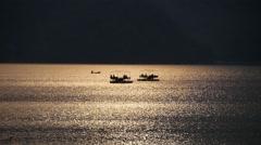Two catamaran at sunset Stock Footage