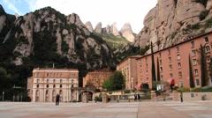 View to the abbey Santa Maria de Montserrat in Monistrol de Montserrat, Spain. Stock Footage