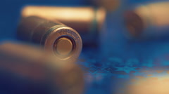 Several of new, not shooting bullet caliber 9mm on reflective surface. Closeup - stock footage