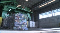 Waste for recycling purposes being loaded Stock Footage