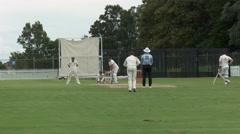 Cricket batsman plays a cut shot Stock Footage