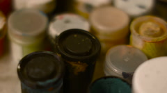 Jars of Paint in the Artist Studio Transfer Focus Stock Footage
